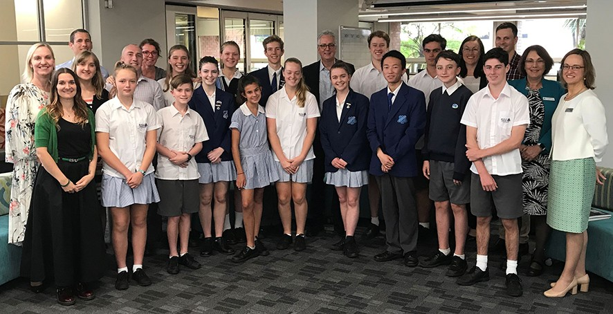 Staff and students in the school library with Department of Education Secretary Mr Scott