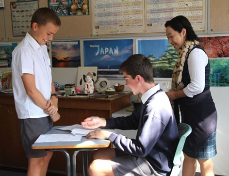 Year 8 Japanese students role playing in Japanese restaurant